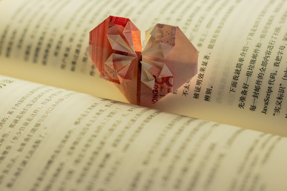red and white cube on book page