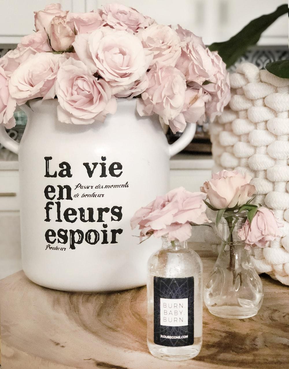 white ceramic mug with white and pink roses