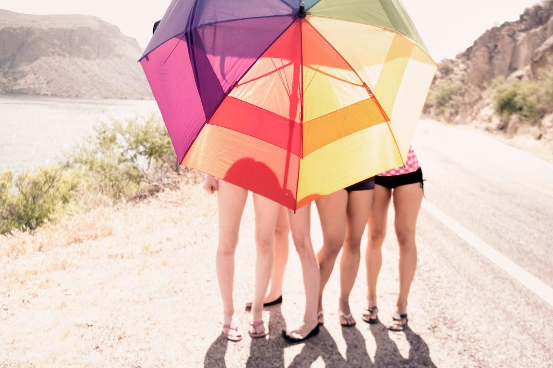 Girls With Umbrella Near Canyon Lake, Az - unsplash