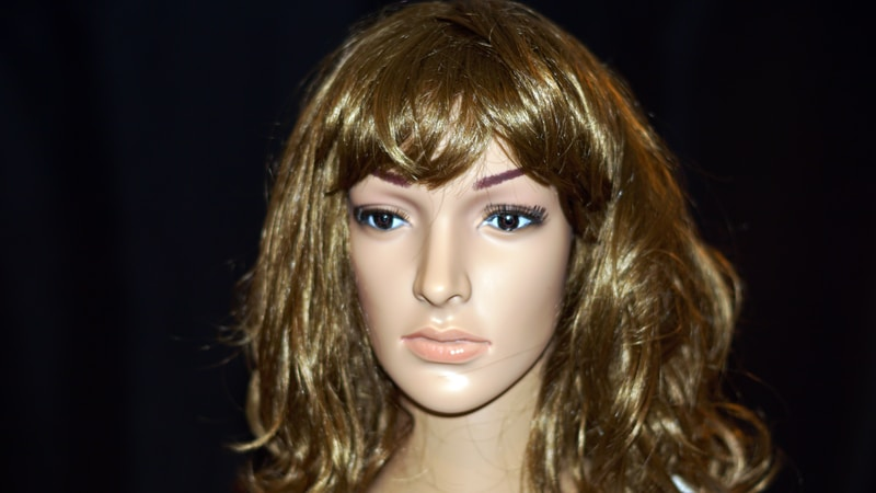 brown haired doll with red lipstick