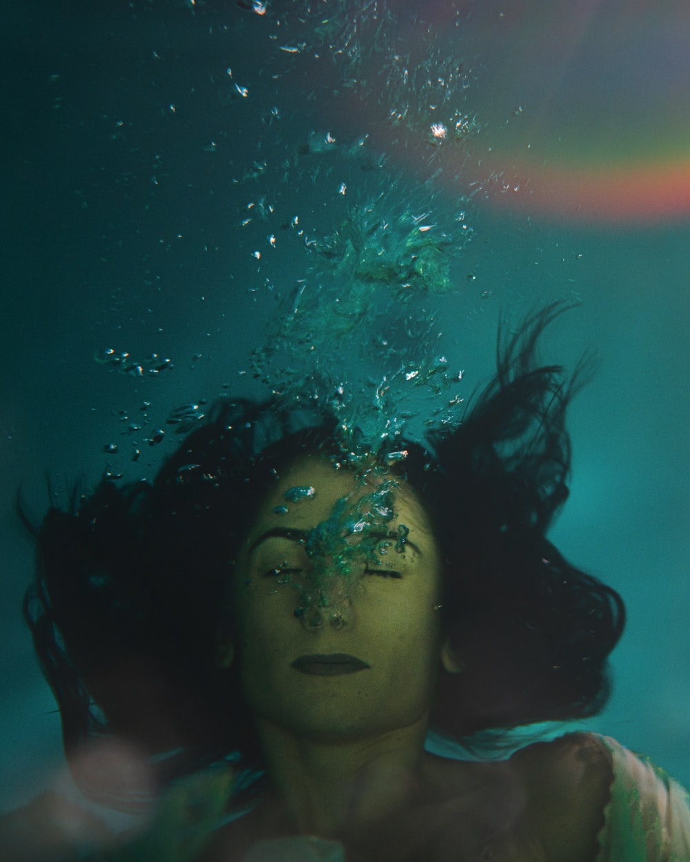 woman in white tank top under water