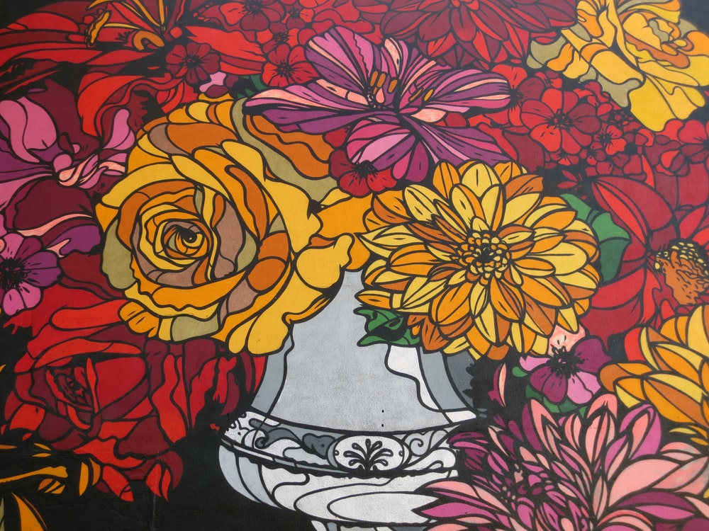 yellow red and black floral textile