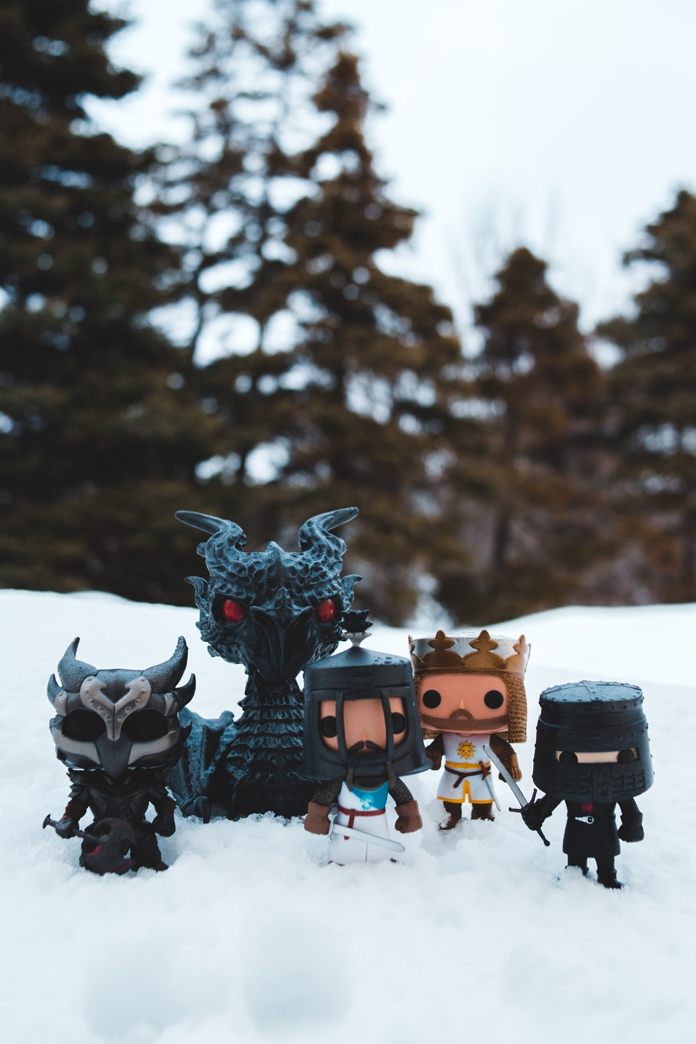 brown and black robot toys on snow covered ground