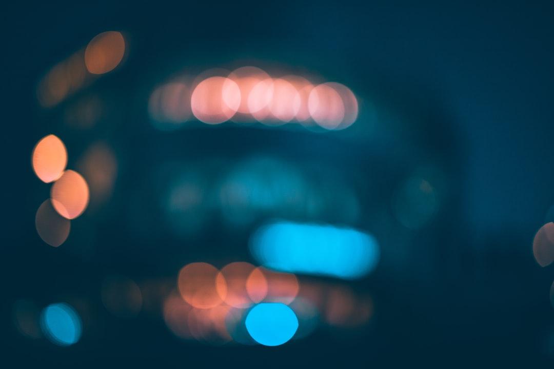 Blue and White Bokeh Lights - unsplash