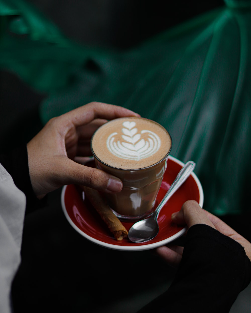 person holding white ceramic mug with coffee
