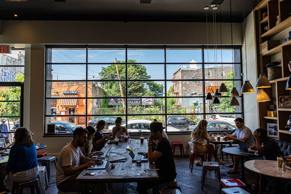 people sitting on chair in restaurant during daytime