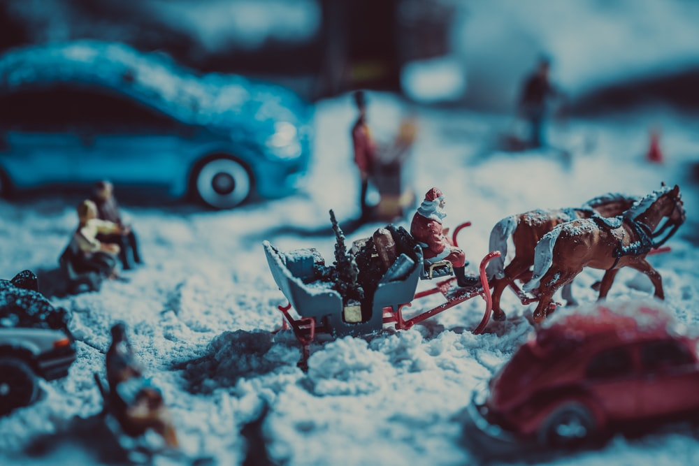 red and white plastic toy on snow covered ground
