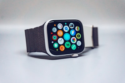 black smart watch with black strap apple watch zoom background