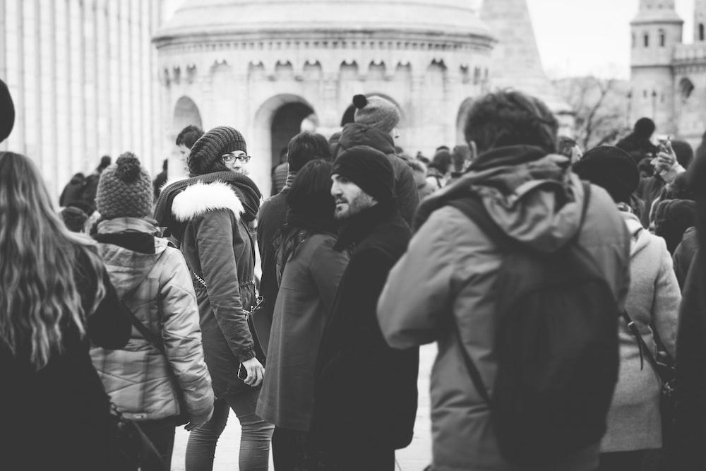 grayscale photo of people walking on street