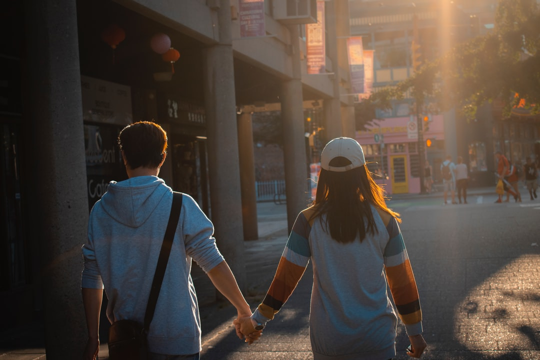 Couple holding hands on the streets of Vancouver