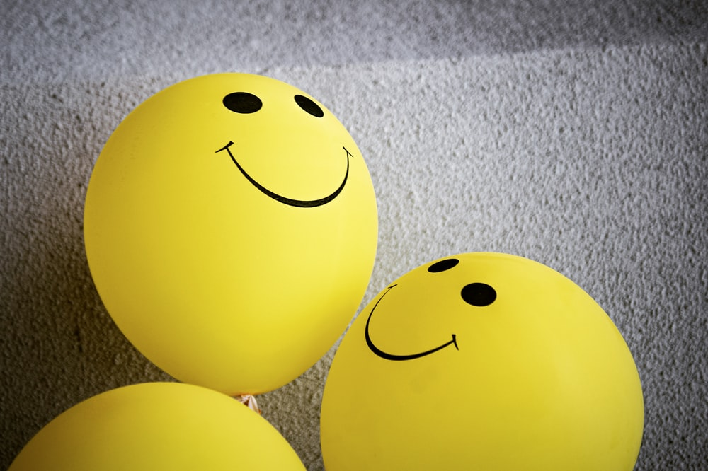 yellow smiley emoji on gray textile