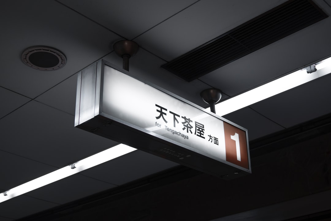 天下茶屋 Platform Sign In Osaka, Japan - unsplash