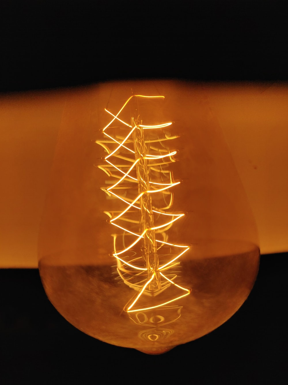 clear glass bottle with string lights