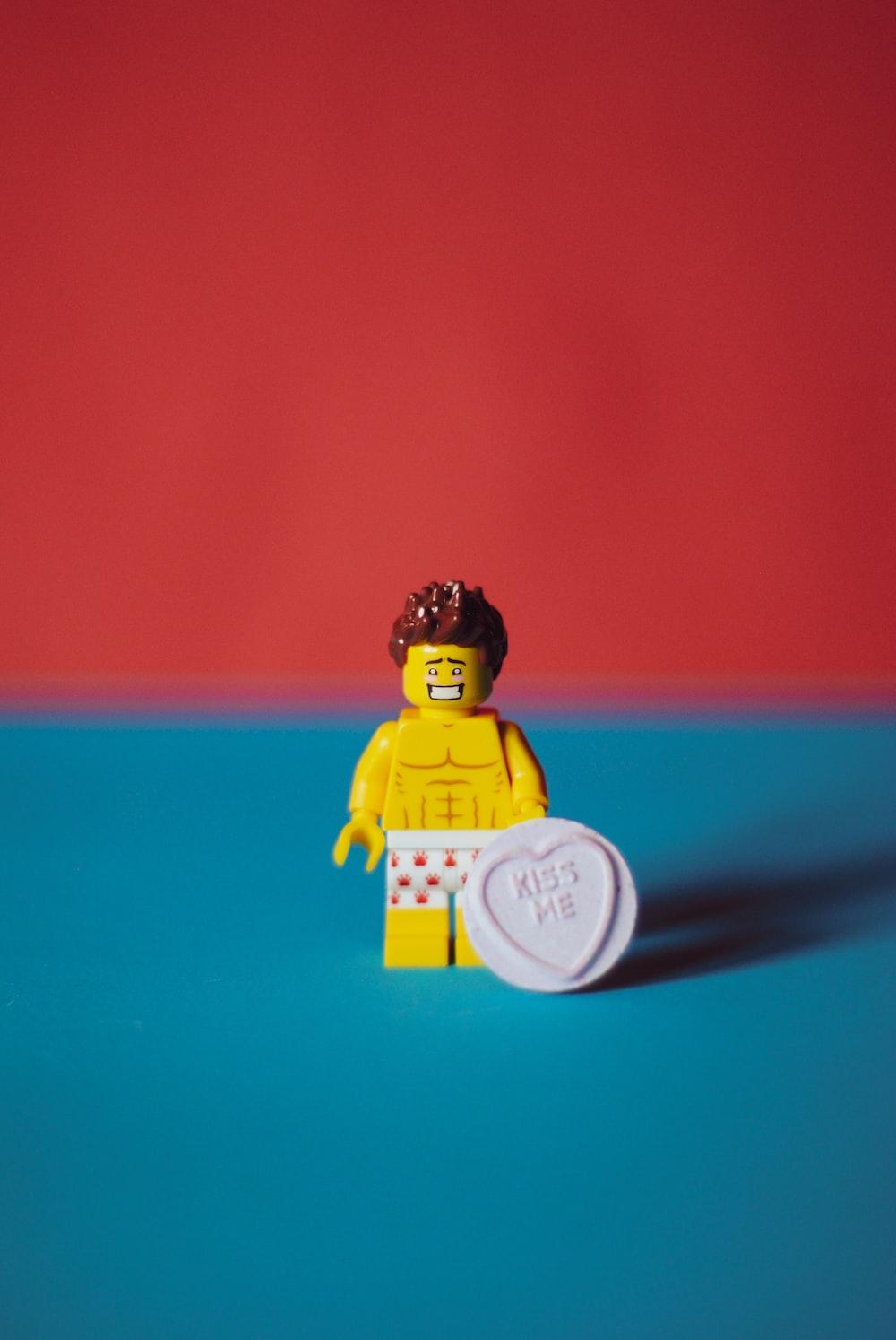 yellow and black lego mini figure