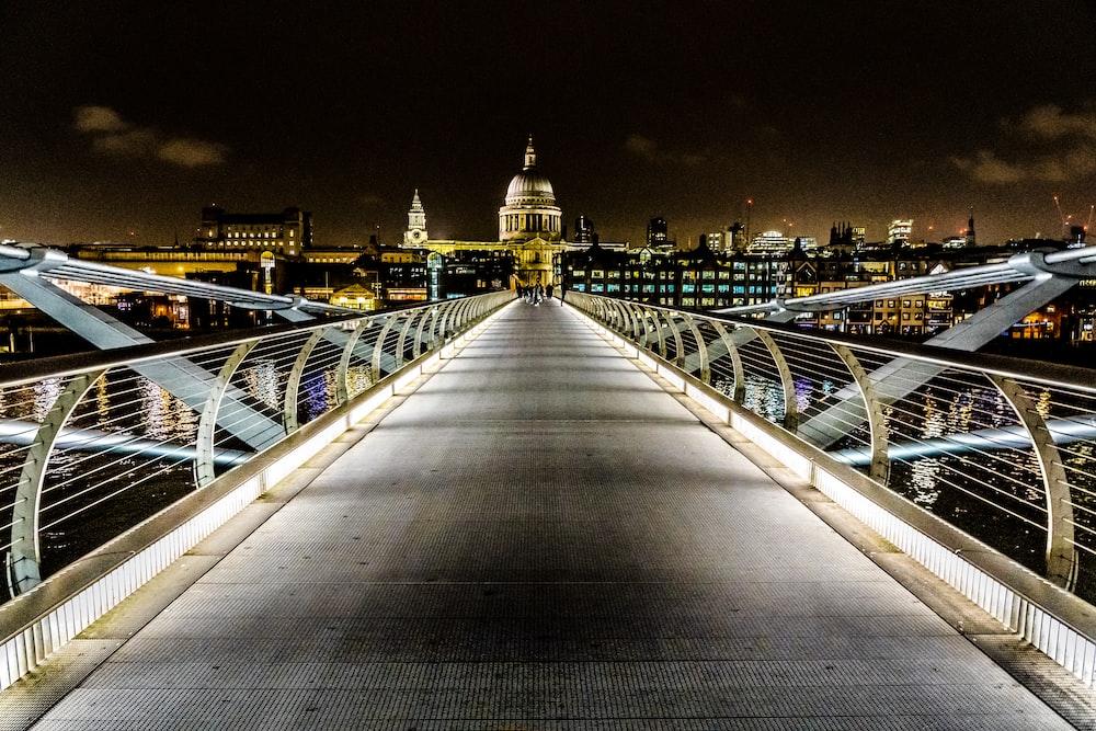 gray metal bridge during night time