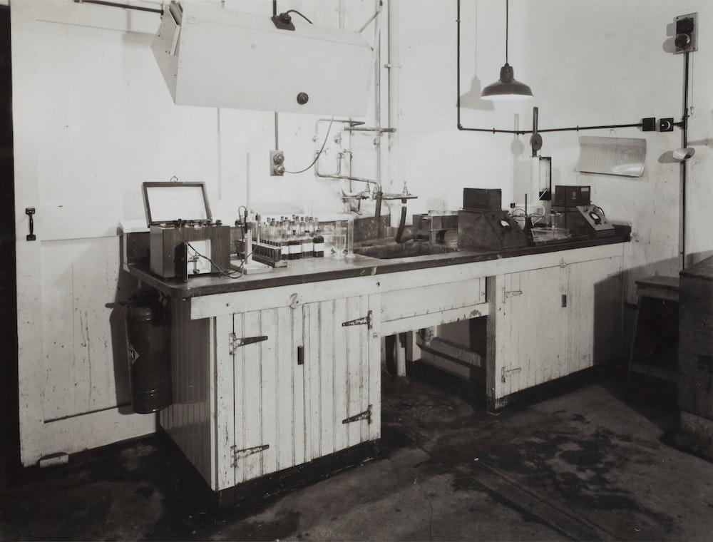 white wooden cabinet beside brown wooden desk