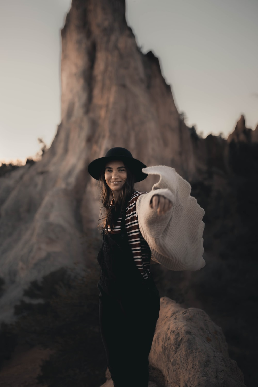 woman in black jacket wearing white scarf