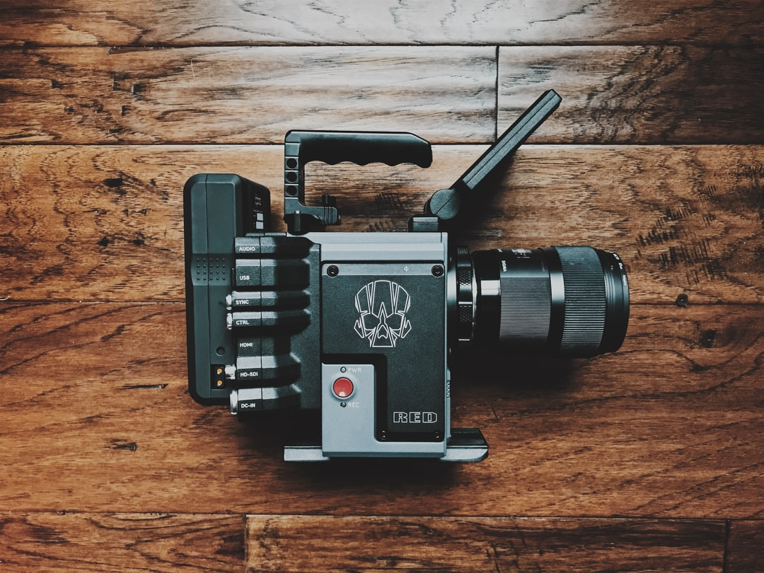 Black and Gray Dslr Camera On Brown Wooden Table - unsplash
