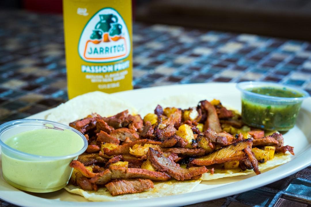 Tacos a la Pastor with a Jarritos Mexican Soft Drink.