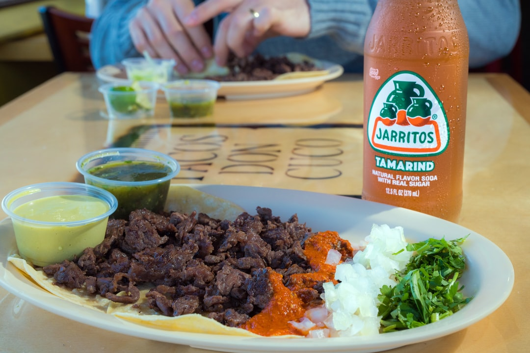 Eating Arrrachera (steak) Tacos with a Jarritos Mexican Soft Drink.