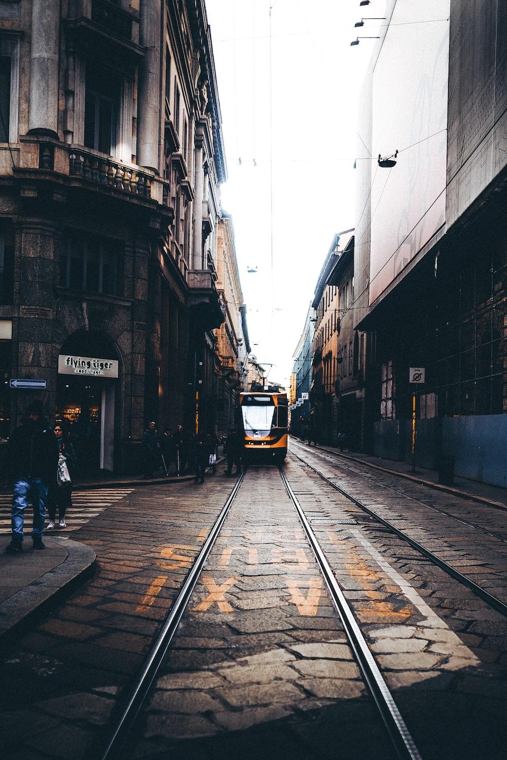 people walking on street beside buildings during daytime