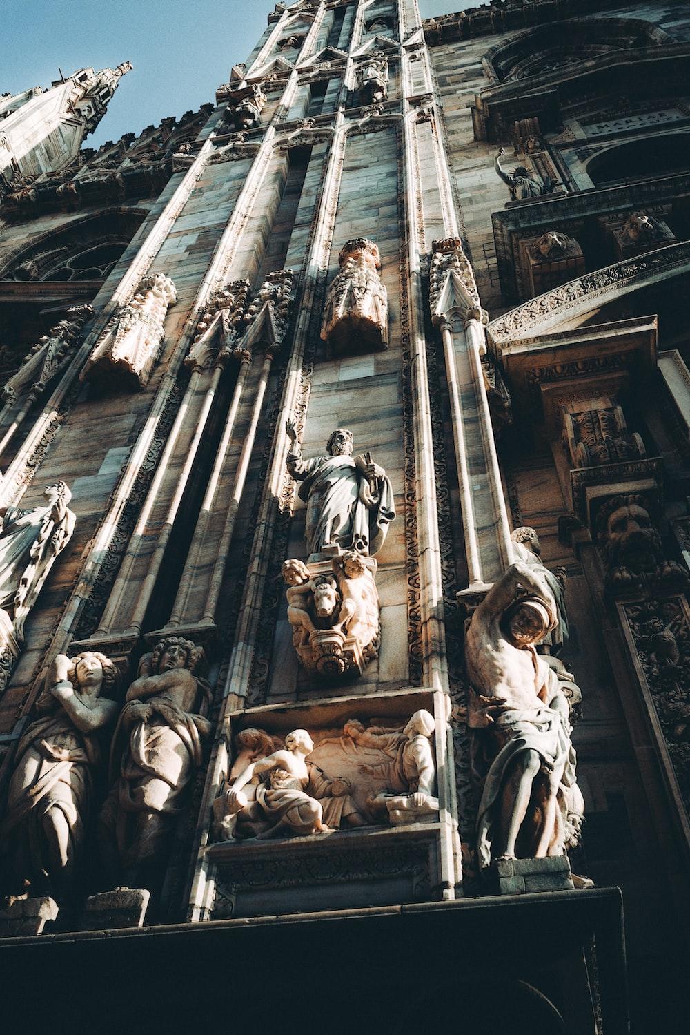 grayscale photo of concrete statues