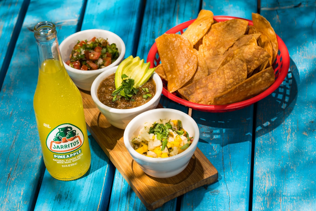 Jarritos Pineapple with Chips and Traditional Mexican Salsas
