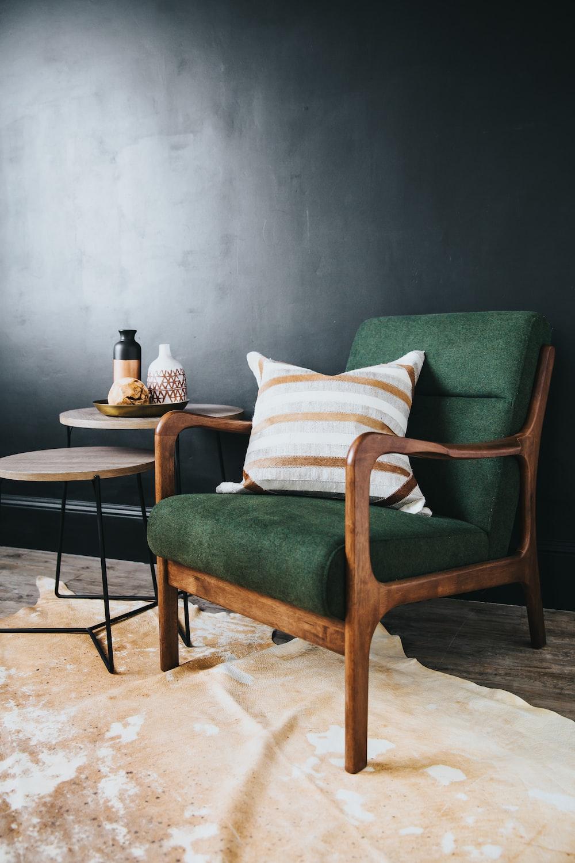 white throw pillow on green sofa chair