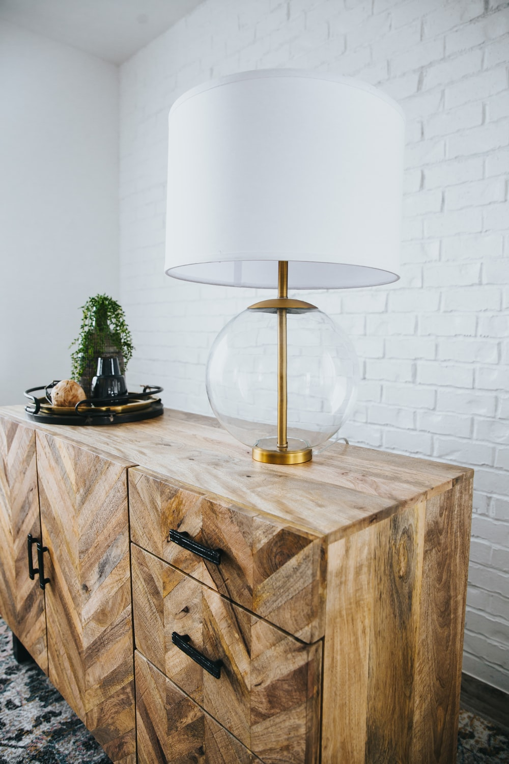 gold and white table lamp on brown wooden table