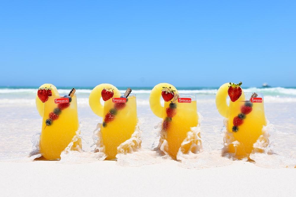 yellow ice cream on white sand during daytime