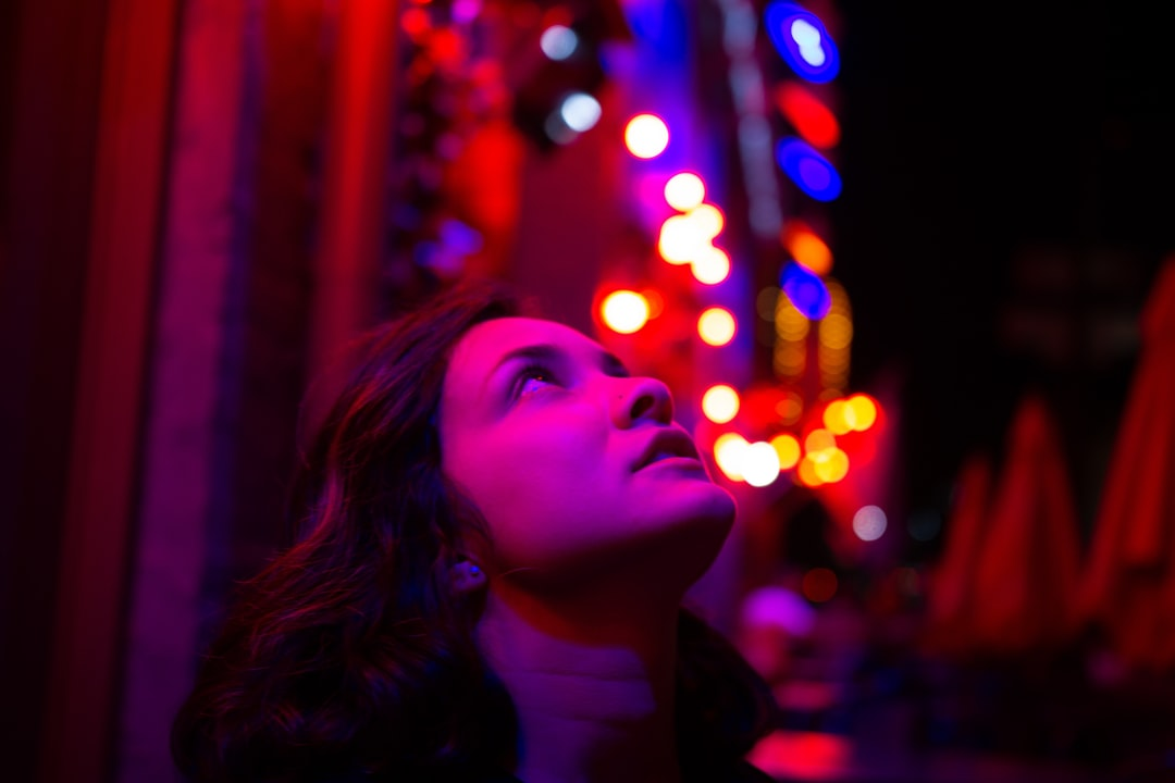 girl looking up in red lights