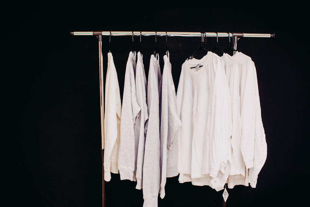 white dress shirt hanging on clothes hanger