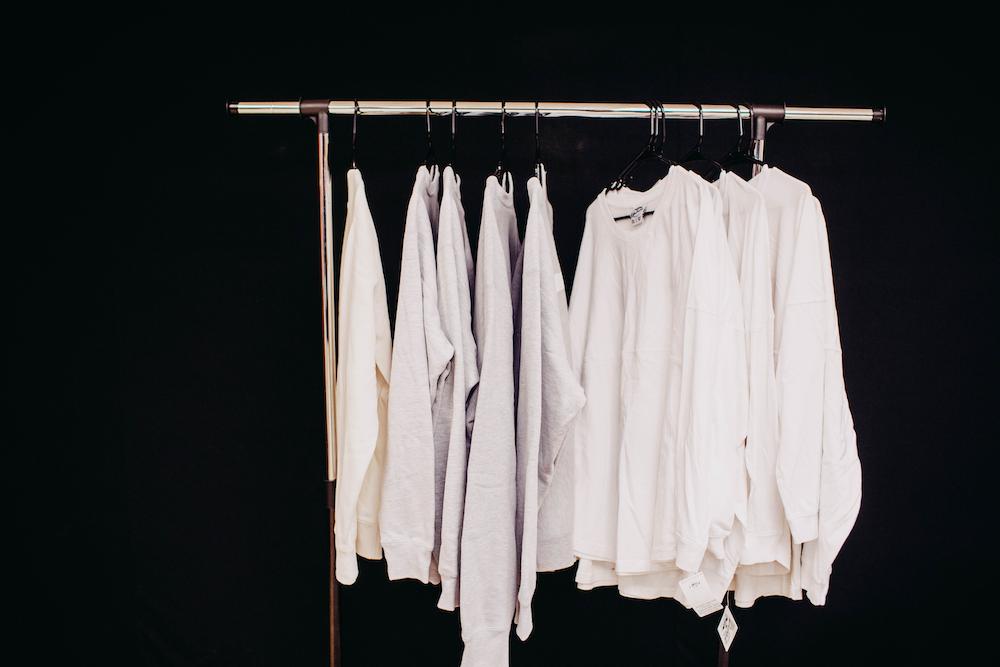 white dress shirt hanging on clothes hanger