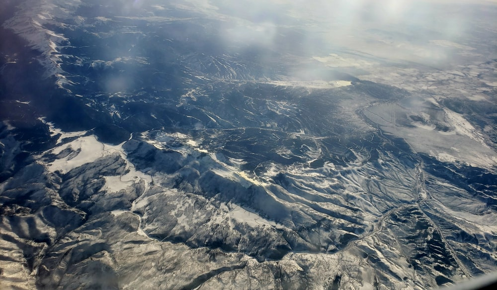 birds eye view of mountains covered with clouds