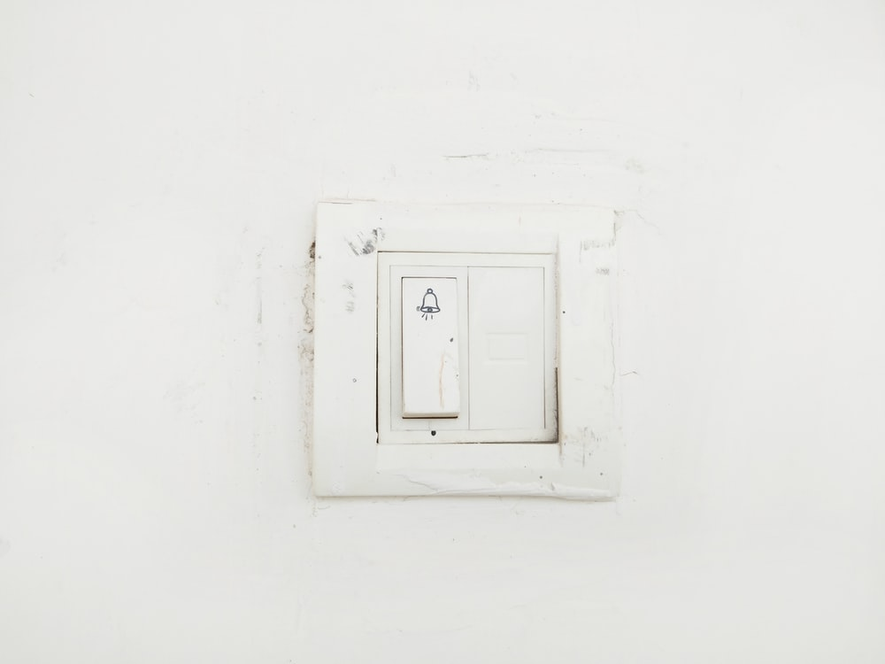 white switch mounted on white painted wall