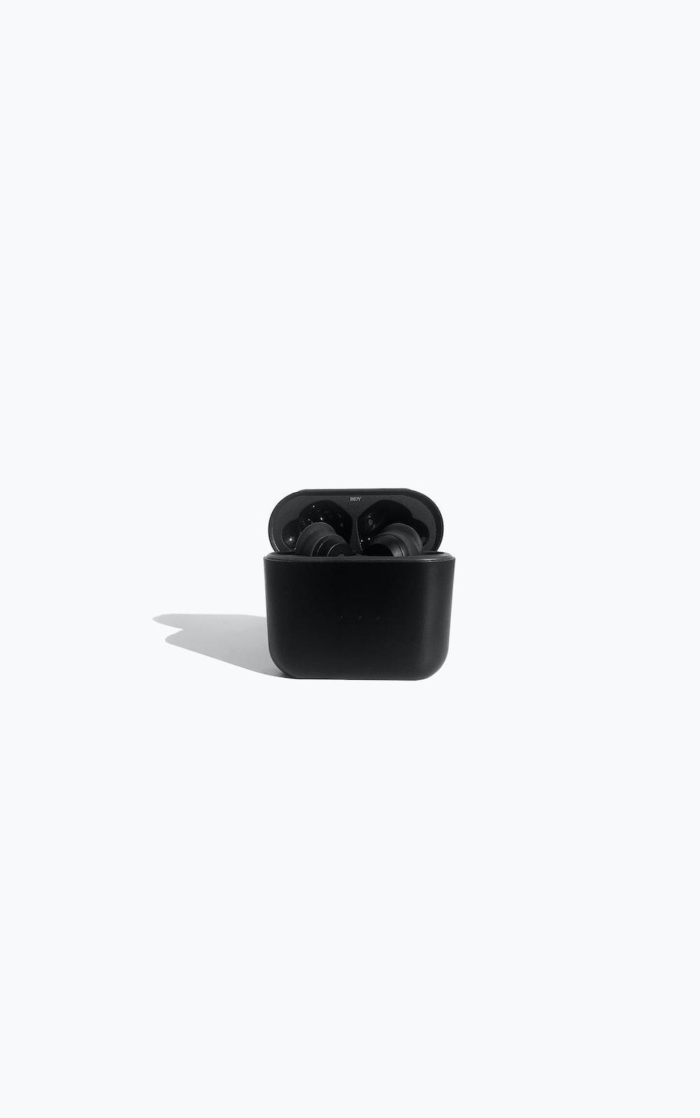 black ceramic mug on white table