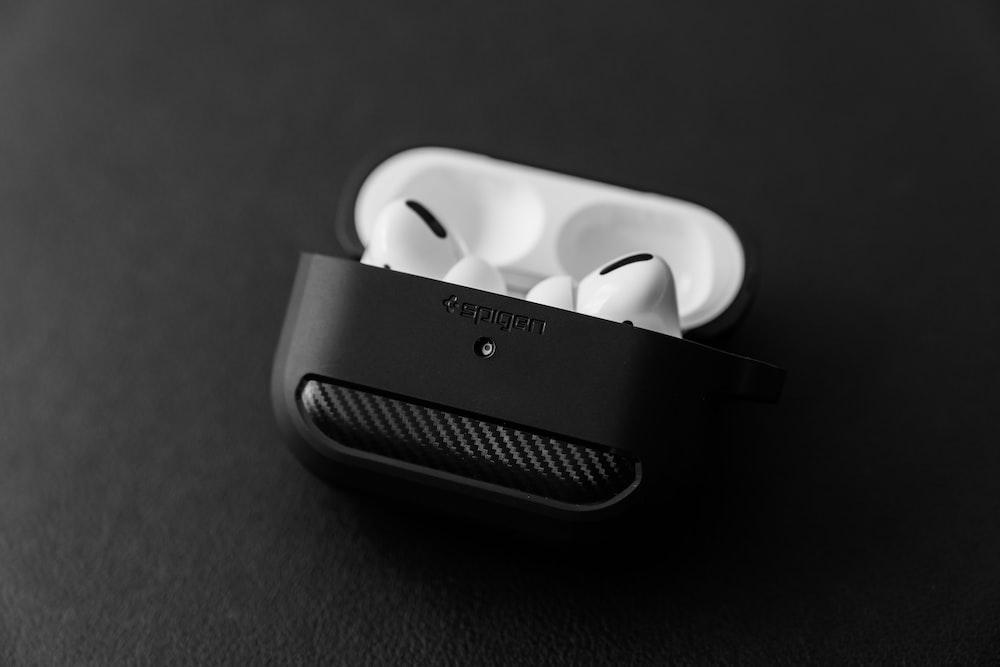 white apple earpods in black case