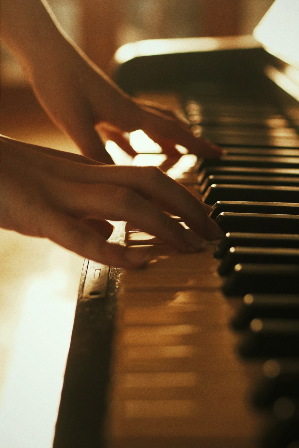 person playing piano during daytime