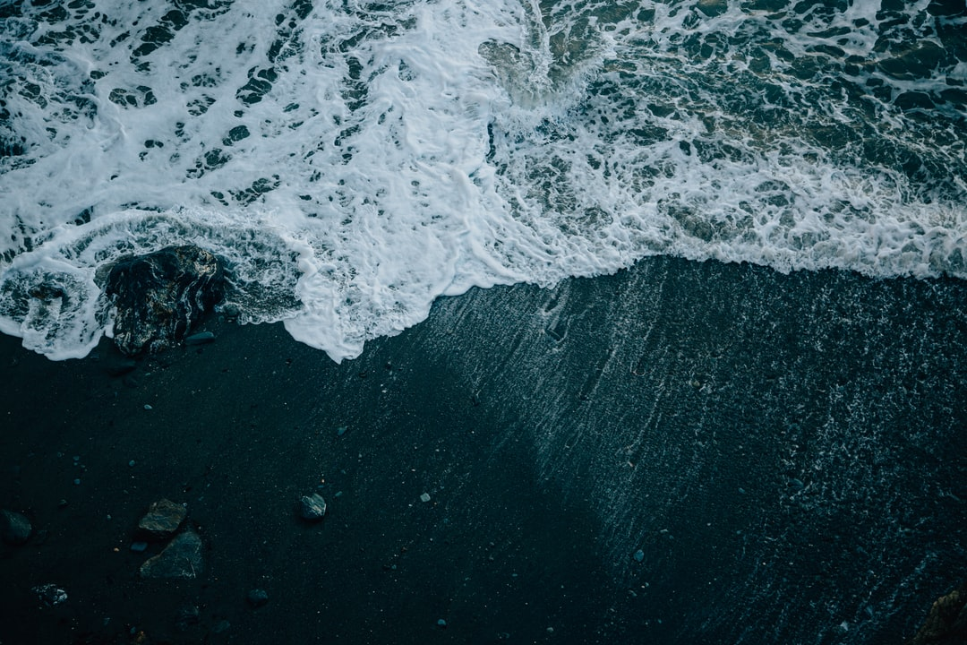 Ocean Waves Crashing On Shore During Daytime - unsplash