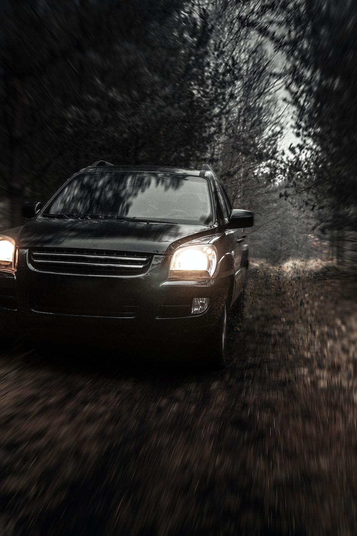 black car on road during daytime
