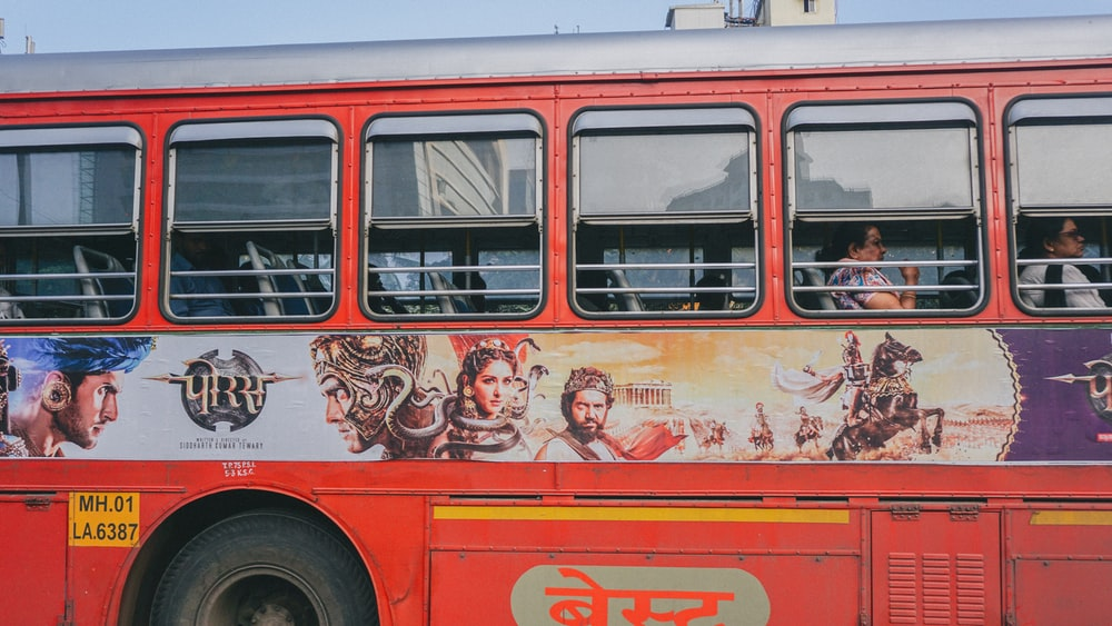 red and white bus with graffiti
