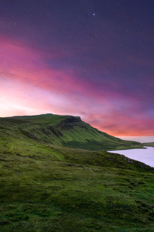 green mountain under purple sky