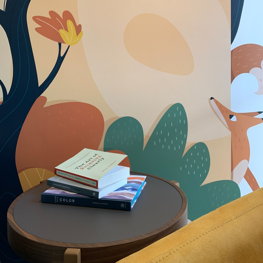 books on brown wooden round table