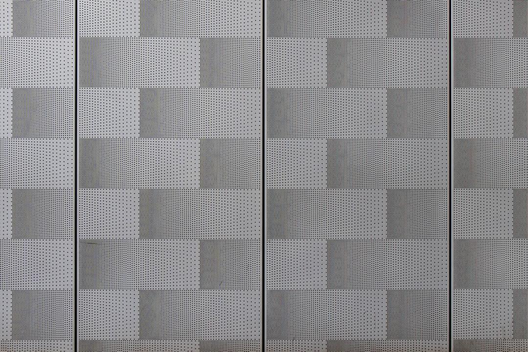 White and Black Checkered Textile - unsplash