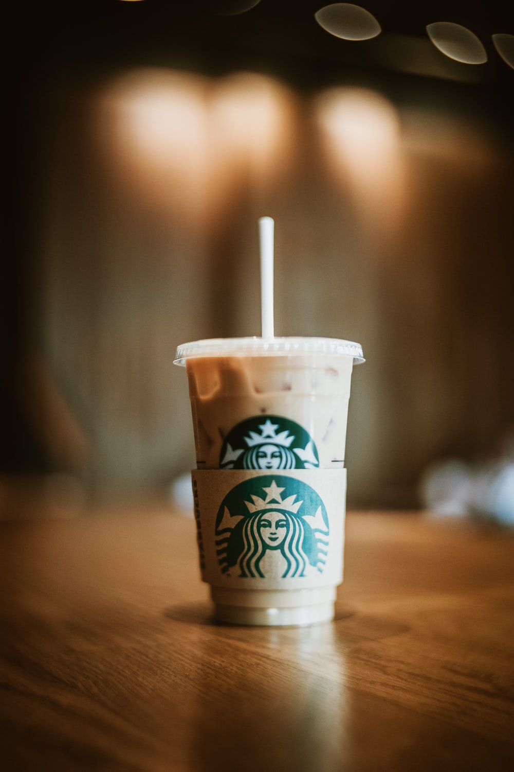white and brown starbucks disposable cup