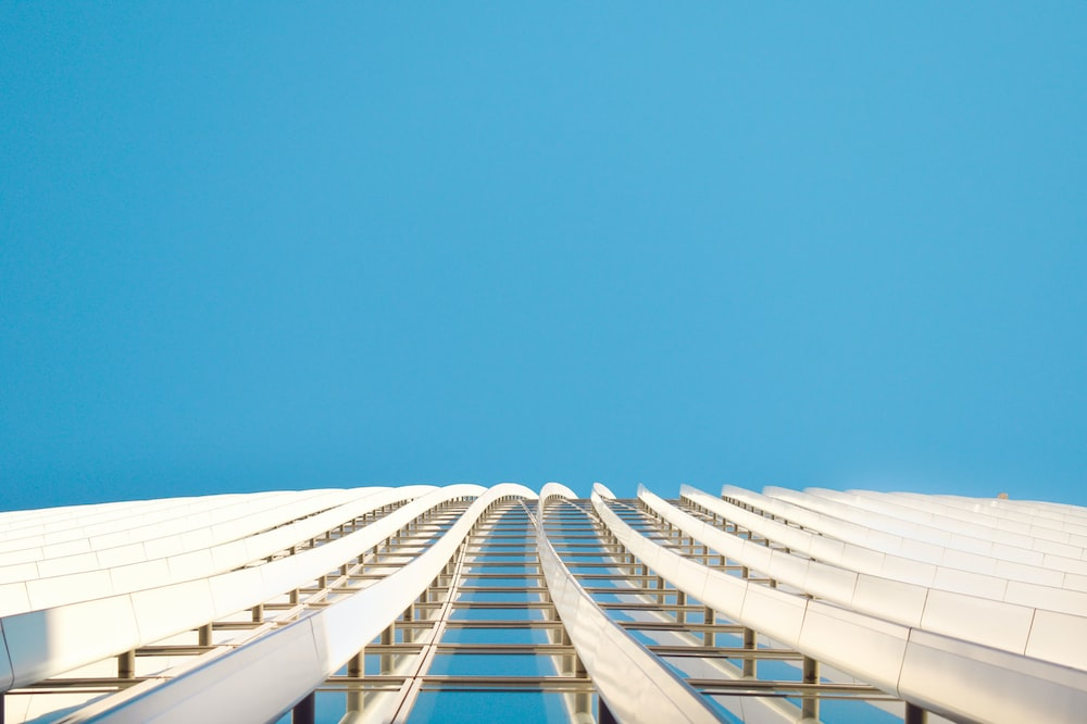 white and blue building under blue sky during daytime