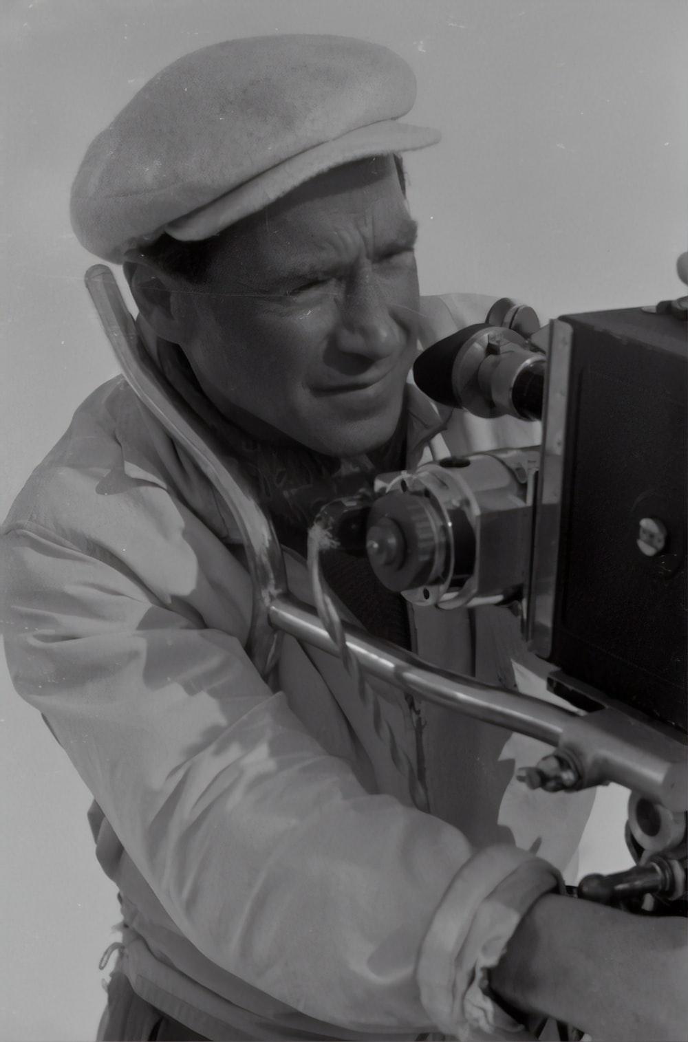 man in gray jacket using black dslr camera
