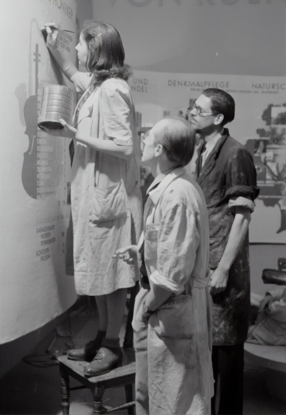grayscale photo of man and woman standing beside boy