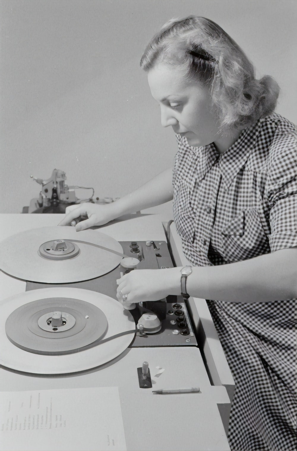 man in black and white checkered button up shirt playing dj turntable