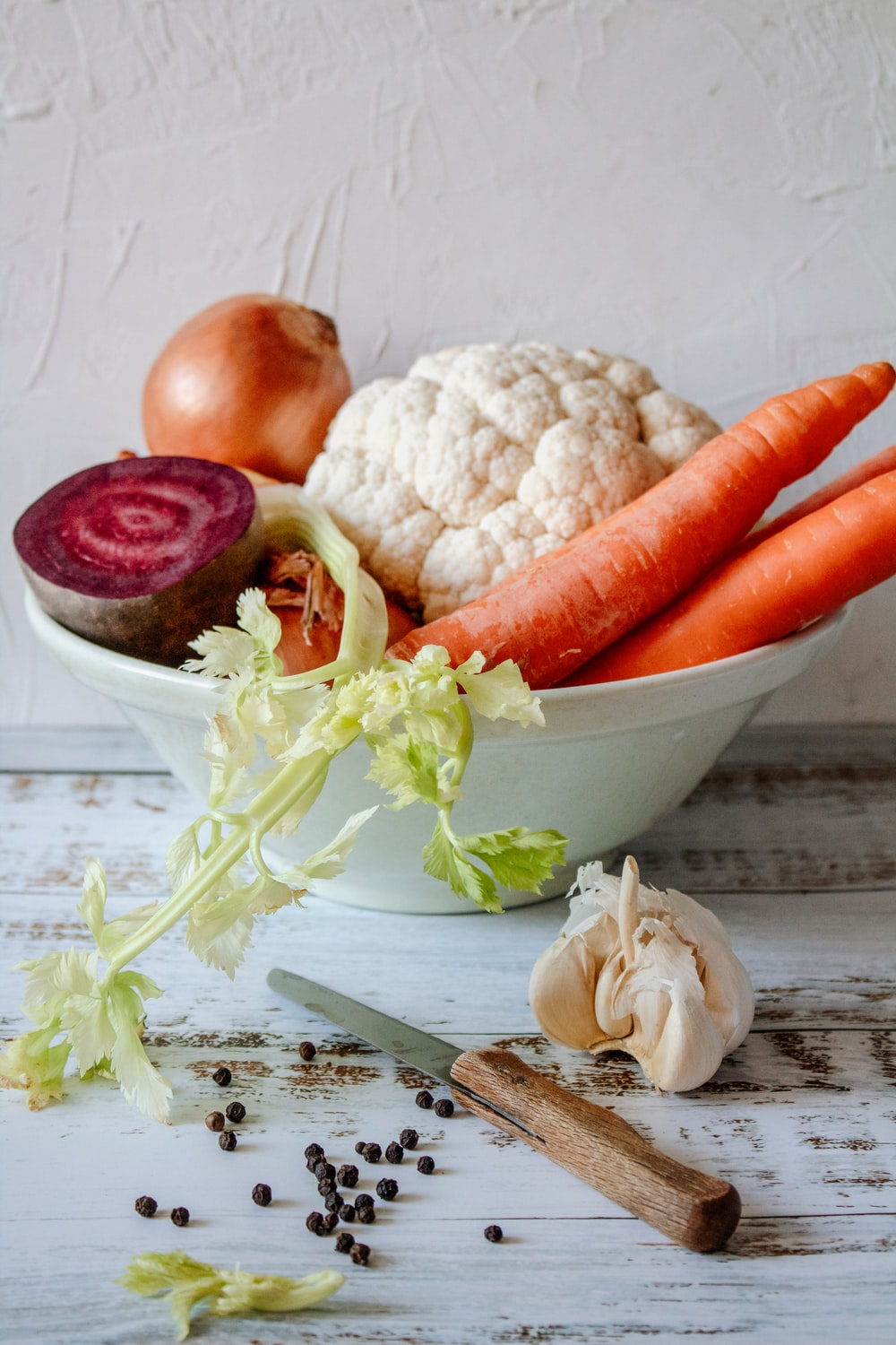 carrots and garlic in white ceramic bowl
